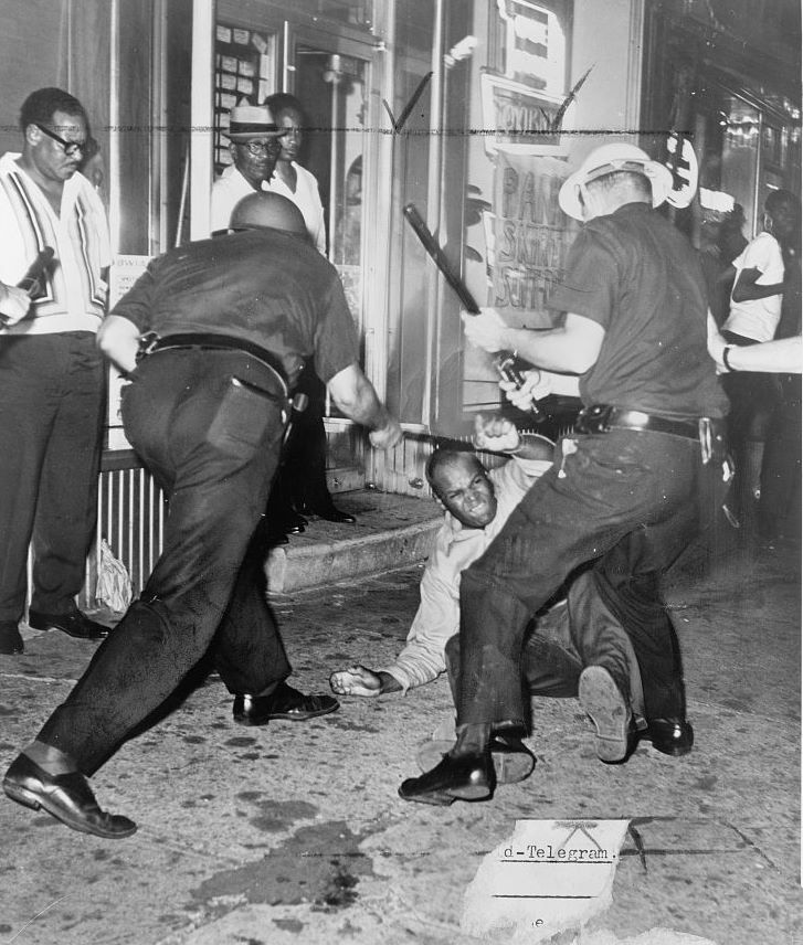 An incident at 133rd Street and Seventh Avenue during the Harlem riot of 1964. From Wikipedia.